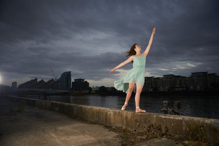 out of context: Ballet dancer reaching upwards on wall LANG_EVOIMAGES