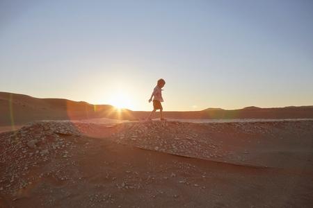 vlei: Boy walking on sand dune, Namib Naukluft National Park, Namib Desert, Sossusvlei, Dead Vlei, Africa