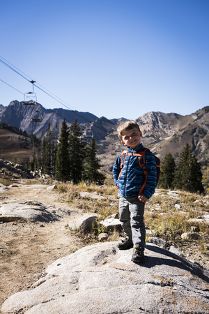 Toddler posing, Catherines Pass Trail, Albion Basin, Alta, Utah, USA LANG_EVOIMAGES