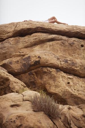stoney: Woman relaxing on rock formation, Stoney Point, Topanga Canyon, Chatsworth, Los Angeles, California, USA