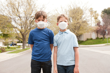 out of context: Two boys wearing dust masks LANG_EVOIMAGES