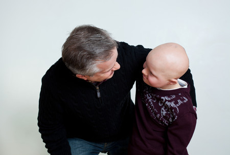 50 54 years: Father son with Downs Syndrome looking at each other