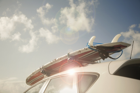 Surfboard on top of car