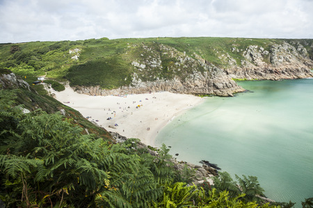 View of holiday makers on beach, Porthcurno, Cornwall, UK LANG_EVOIMAGES