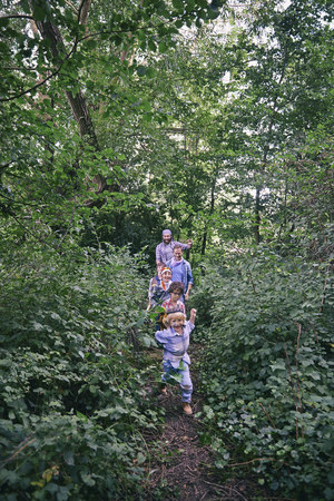 50 54 years: Fathers and sons playing chase in forest
