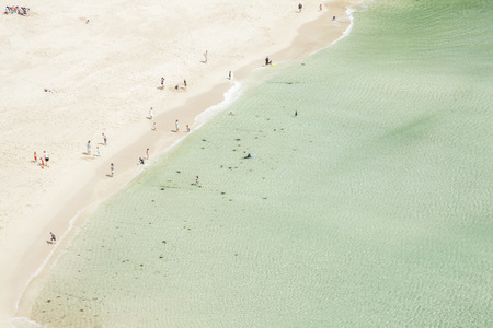Aerial view of holiday makers on beach, Porthcurno, Cornwall, UK