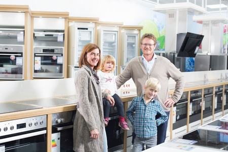 hobs: Portrait of family with two children browsing hobs in electronics store