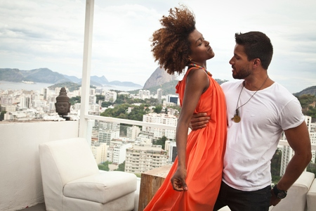 honeymooner: Couple dancing on terrace, Sugarloaf Mountain in background, Rio, Brazil