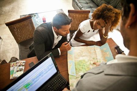 honeymooner: Couple checking in at hotel reception desk