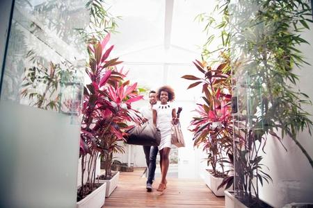 honeymooner: Couple arriving into apartment building