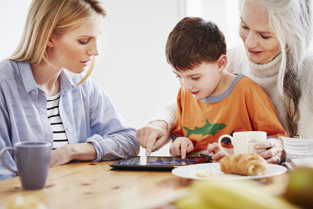 silver surfer: Three generation family using digital tablet LANG_EVOIMAGES