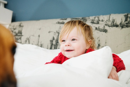 smiing: Boy smiing in bed