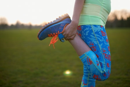 Cropped image of woman stretching leg for exercise in park LANG_EVOIMAGES