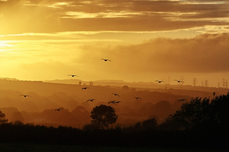 cumbria: Silhouetted landscape of Lake District at sunset, Cumbria, UK