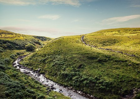 brecon beacons: River flowing through rolling landscape, Brecon Beacons, Wales, UK LANG_EVOIMAGES