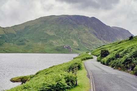 cumbria: Rural lakeside road, Lake Buttermere, Cumbria, UK LANG_EVOIMAGES
