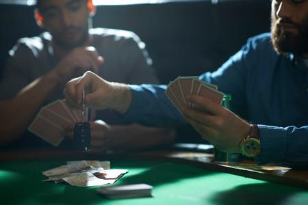 Man Gambling Car Key Playing Card Game At Pub Card Table Stock Photo    86761895