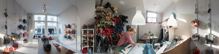 50 54 years: Wide angle view of woman in workshop in leather bag shop