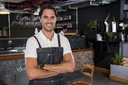 Portrait of happy restaurateur LANG_EVOIMAGES