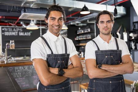 Portrait of happy restaurateurs