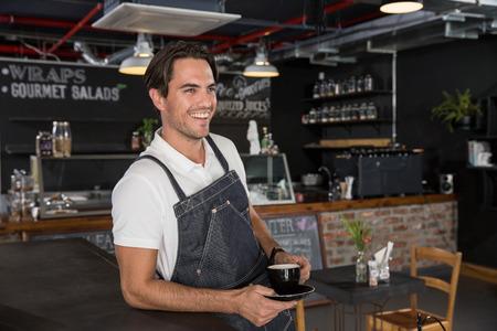 Happy restaurateur taking coffee break