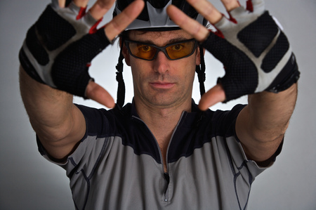 Bicyclist wearing helmet and gloves