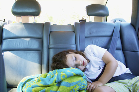 trusted: Girl asleep in car with seat belt on LANG_EVOIMAGES