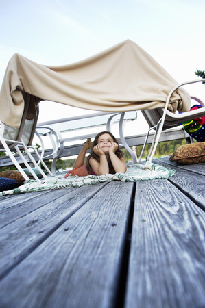 trusted: Young girl in homemade fort