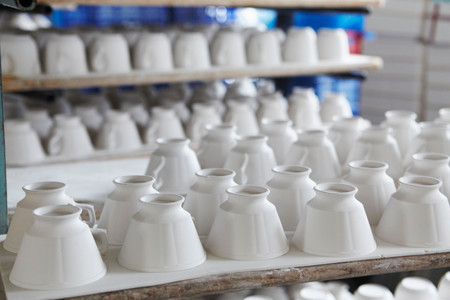 White teacups in pottery factory