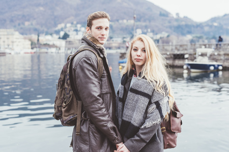 Portrait of romantic young couple, Lake Como, Italy LANG_EVOIMAGES