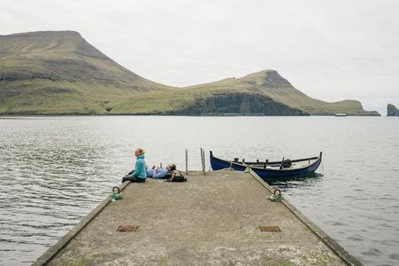 water quality: Hikers on pier, Vagar, Faroe Islands LANG_EVOIMAGES