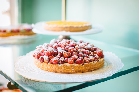 sell: Strawberry tart in cake shop window, Florence, Italy