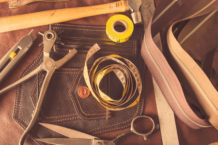 Still life of dressmaking equipment in leather jacket manufacturers, close-up LANG_EVOIMAGES