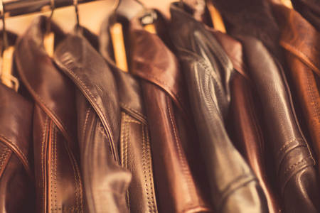Leather jackets hanging in a row, in leather jacket manufacturers, close-up