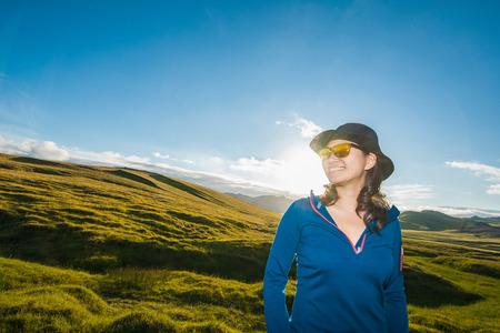 Portrait of woman on rolling landscape, Thakgil, Vik, Iceland