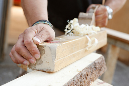 Cropped view of man using wood plane