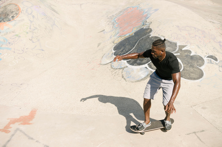 brixton: Young male skateboarder skateboarding in skatepark