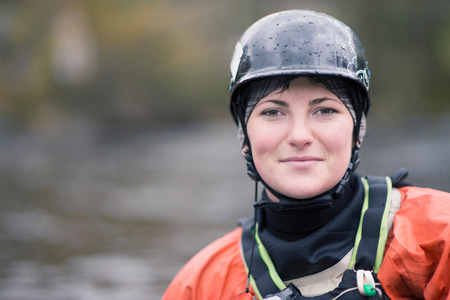Portrait of young female kayaker in watersports helmet LANG_EVOIMAGES