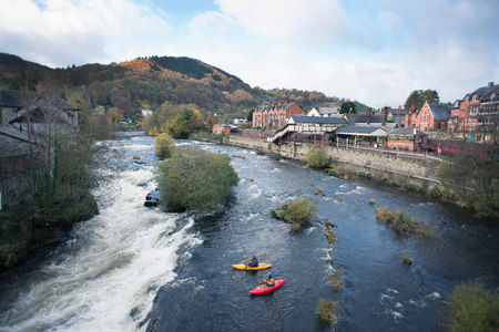 High angle view of two kayakers at the edge  of River Dee rapids, Llangollen, North Wales