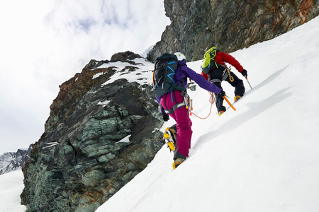 25 35: Mountaineers ascending snow-covered mountain, Saas Fee, Switzerland