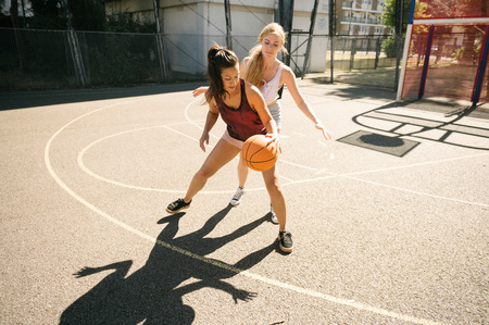 brixton: Two female basketball players practising on basketball court