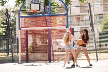 brixton: Two woman practising on basketball court