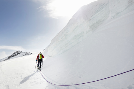 Rear view of mountaineer ski touring on snow-covered mountain, Saas Fee, Switzerland