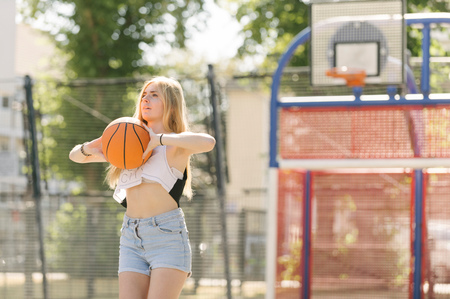 brixton: Young woman practising on basketball court