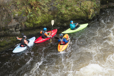 25 35: High angle view of kayakers on River Dee rapids, Llangollen, North Wales LANG_EVOIMAGES