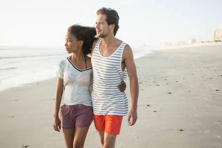 Romantic young couple strolling on beach, Cape Town, Western Cape, South Africa