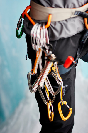 Cropped close up of carabiners on climbers harness LANG_EVOIMAGES