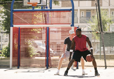 brixton: Two male basketball players practising on basketball court
