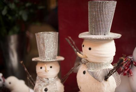 Christmas snowmen in Covent Garden shop window, London, UK