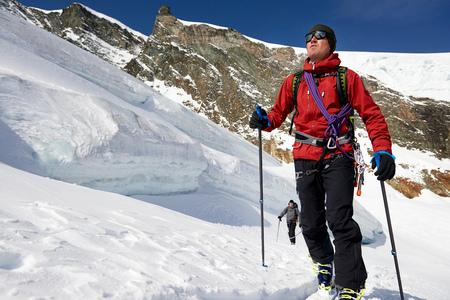 Man ski touring on snow-covered mountain, Saas Fee, Switzerland LANG_EVOIMAGES